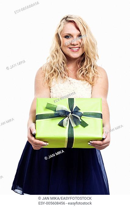 Portrait of beautiful cheerful woman holding green gift box, isolated on white background
