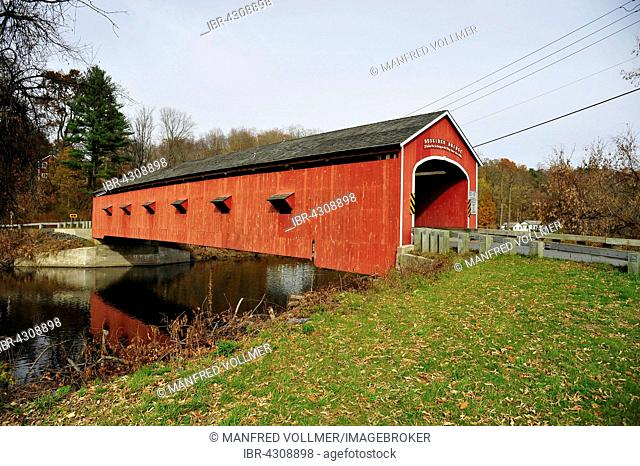 Old wooden bridge Red Covered Bridge over the Hoosic River, Buskirk, New York State, USA