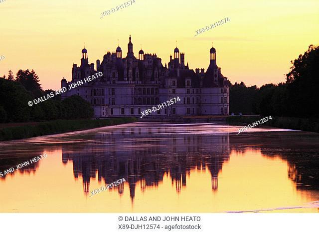 France, Loire Valley, Loir-et-Cher, Chambord, Château de Chambord, East Façade at Sunset