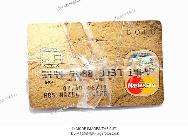 A credit card taped together