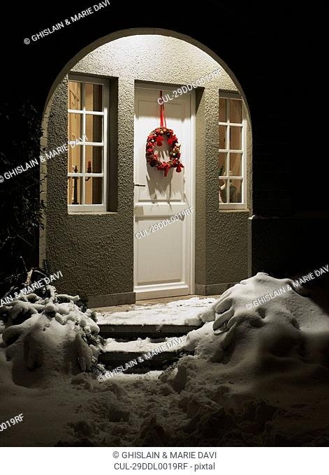 Entrance of a house at christmas eve