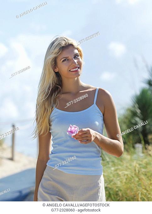 Young woman on the beach. Miami Beach, Florida, USA