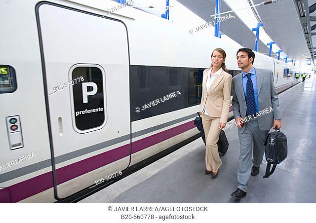 Businessmen. Passengers. AVE, Tren de Alta Velocidad. Train station. Lleida, Cataluña. Spain