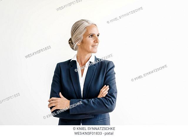 Smiling businesswoman looking sideways