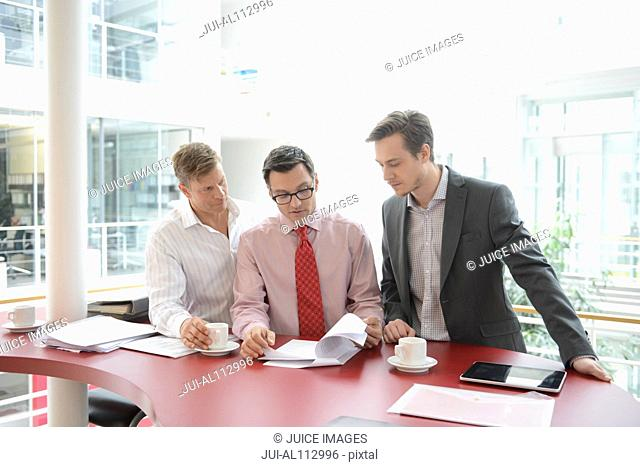 Business colleagues meeting over red table