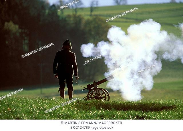 Small cannon being fired on Leonharditag, the festival of St. Leonard of Noblac, Greimharting, community of Rimsting, Chiemgau, Upper Bavaria, Bavaria, Germany