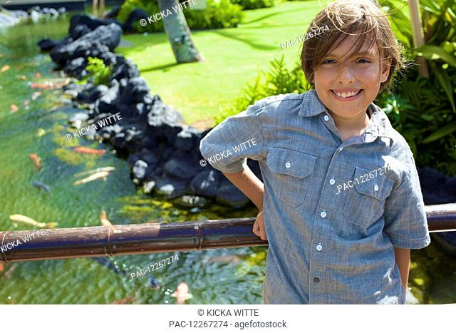 Portrait of a young boy at the Poipu Grand Hyatt Hotel, Southern Kauai; Kauai, Hawaii, United States of America