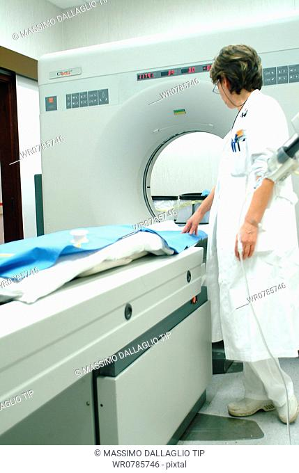 Doctor standing by MRI imaging machine