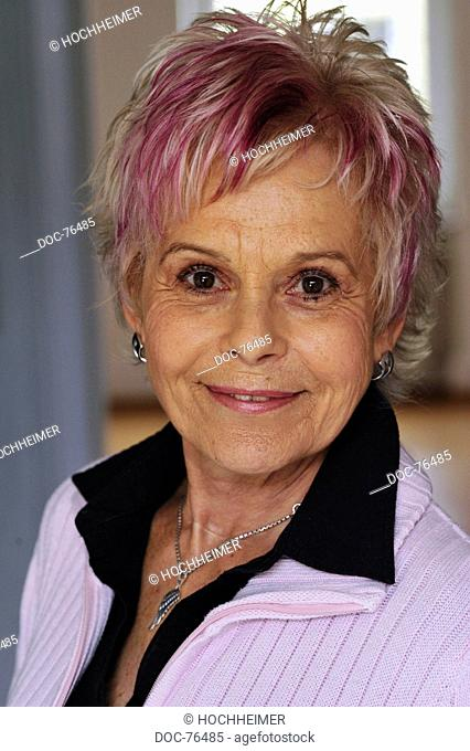 elderly woman with lively hair