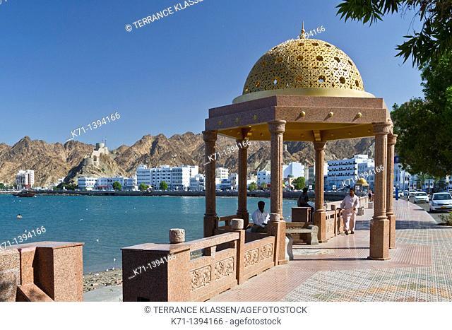 A gold dome cupola shelter on the Corniche promenade in Muscat, Oman