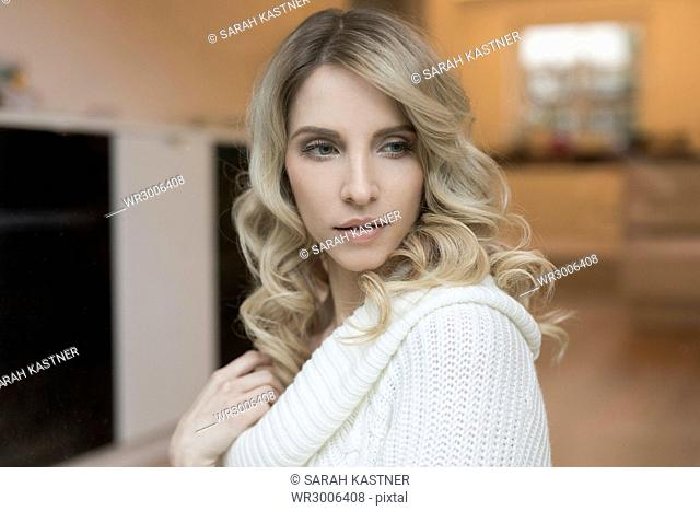 Portrait of a blond woman in the kitchen