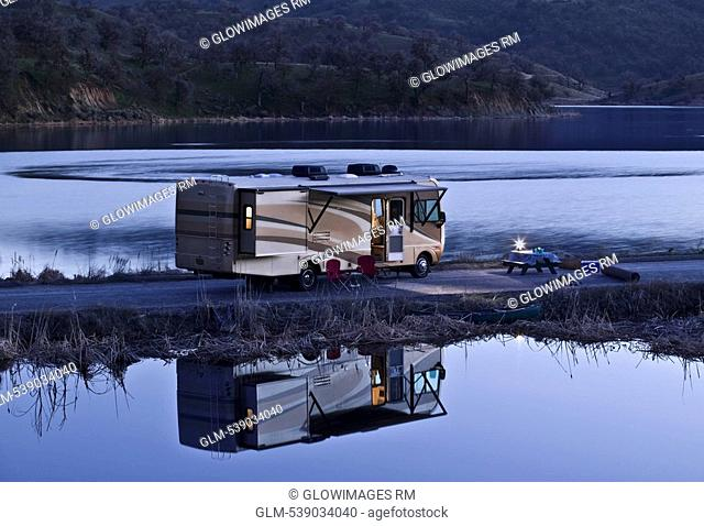 Mobile home parked at the riverside