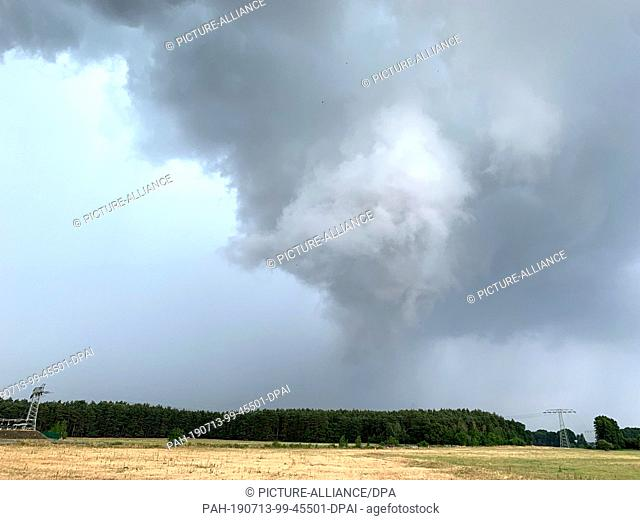13 July 2019, Germany (German), Kroppen: A cloud formation reaches to the ground. Strong thunderstorms swept across the country in the afternoon