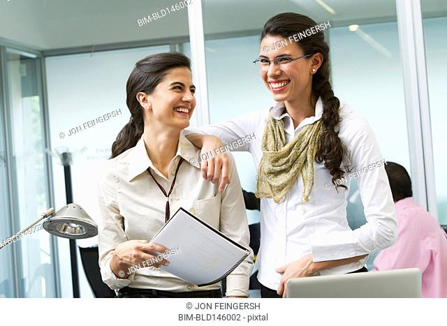 Hispanic businesswomen working together in office