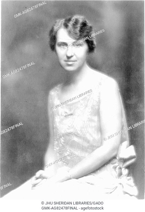 Portrait of Cornelia Gaskins Harcum, PhD graduate in Classics at Johns Hopkins University in 1915, seated wearing formal dress, hands together in lap, waist up