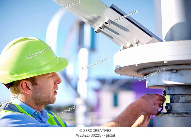 Engineer inspecting wind turbine