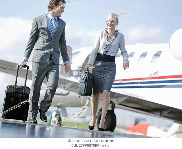 Businessman and businesswoman on the go