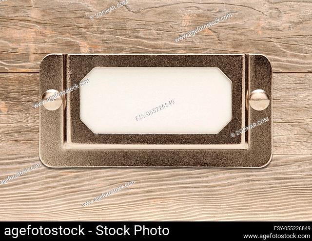 Blank Metal File Cabinet Label Frame on Wood Ready for Your Own Message