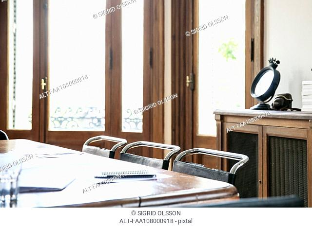 Documents on table in empty office