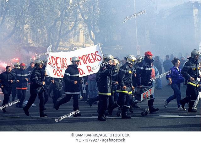 Firemen marching in a demonstration in December 1995, along Castellane Plaza, Marseille, France