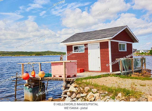 Timber cabin on stilts with fishing nets drying, Newfoundland, Canada