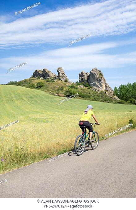 Female cyclist alongside river Pisuerge near Aguilar de Campoo, Palencia Province, Spain