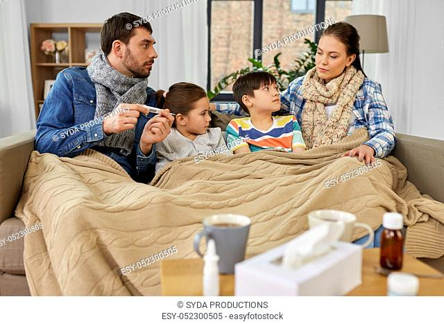 family with ill children having fever at home