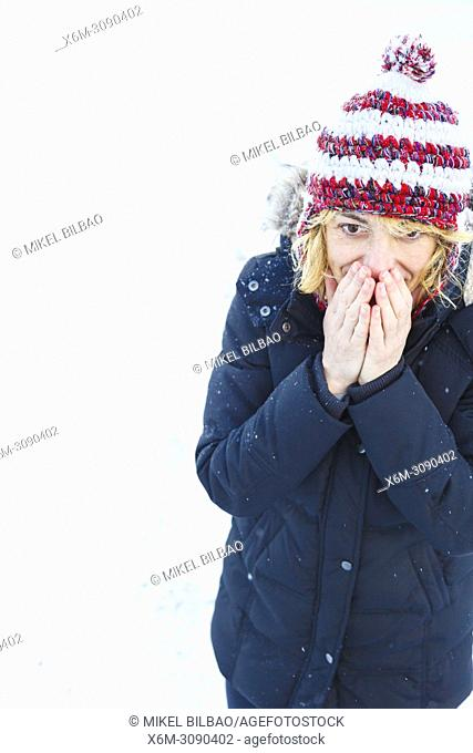 Woman under the snow in winter