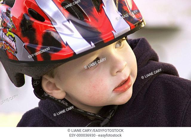 boy wearing bike helmet