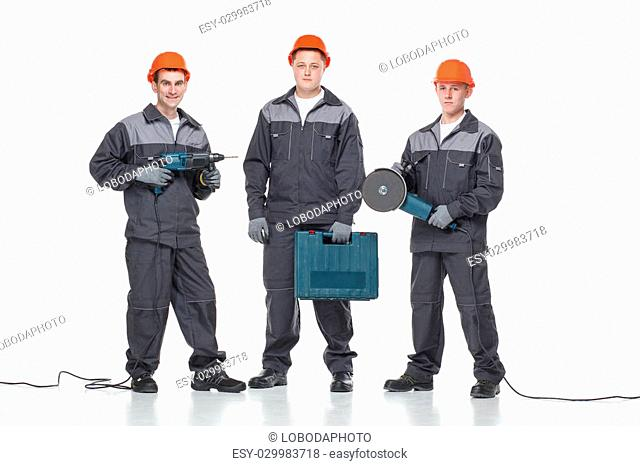 caucasian young different manual worker collection isolated on white with tools