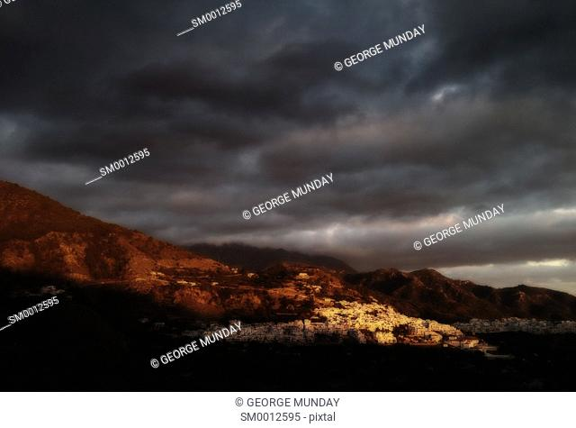 Storm clouds over Frigilina, . Costa del Sol, Malaga Province,. Andalucia, Spain
