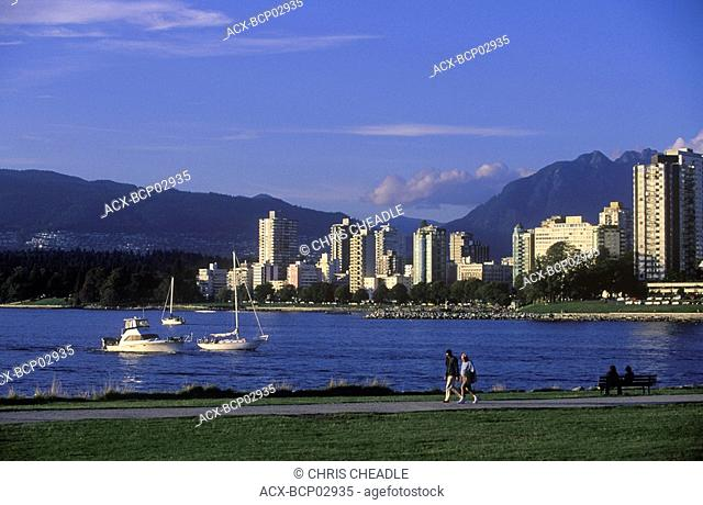 View across English Bay to West End condos with yachts, Vancouver, British Columbia, Canada