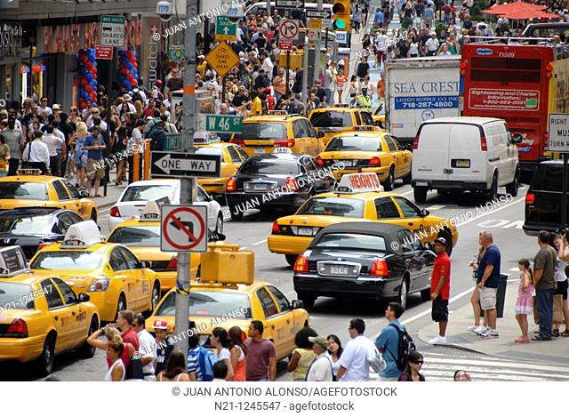 Heavy traffic along Seventh Avenue from Duffy Square. Times Square. Theater District. Manhattan. New York, New York. USA