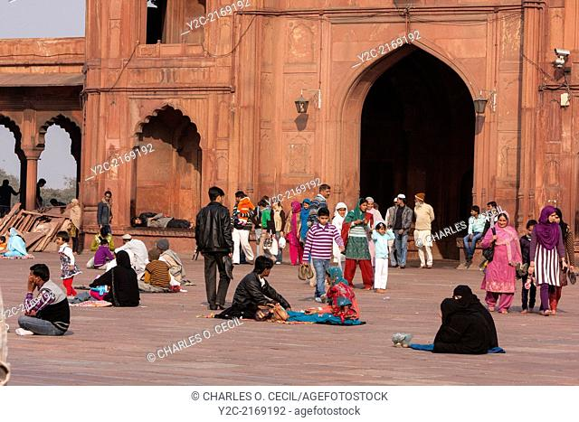 New Delhi, India. Muslims Waiting for Afternoon Prayers in the Courtyard of the Jama Masjid (Friday Mosque)
