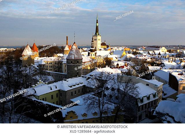 Snowy roofs and St Olaf church in Talin's old town  Christmas in Tallin Estonia
