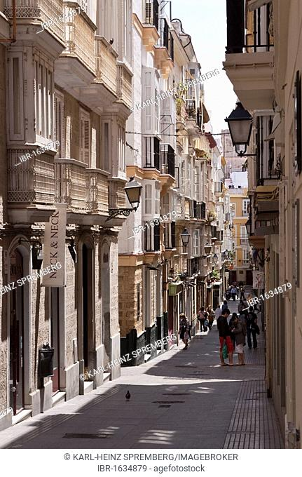 Small alleyway in a shopping district in the port of Cadiz, Andalusia, Spain, Europe