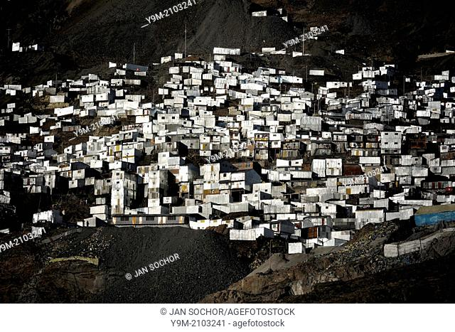 Corrugated metal shacks, homes of the gold miners, seen on a steep mountainside in La Rinconada, Peru, 3 August 2012. During the last decade