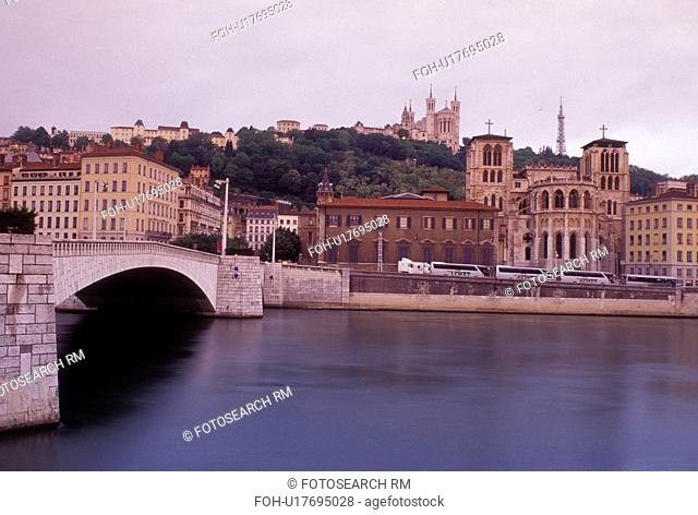 Lyon, France, Rhone-Alpes, Europe, Cathedral Saint Jean (below) and Basilique Notre Dame de Fourviere (above) along the Saone River in Lyon