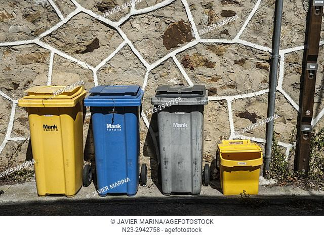 Many coloured recycling bins, Olazti, Pamplona, Navarre, Spain
