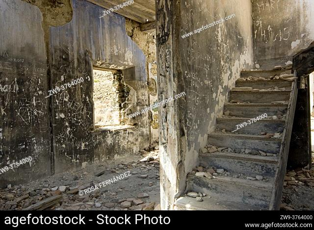 Interior of a ruined Headquarters of Guardia Civil at Loma Pelada showing burned walls and starirs, Los Escullos, Cabo de Gata Natural Park, Nijar, Almeria