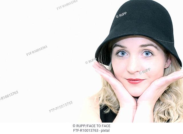 Blond woman with a hat