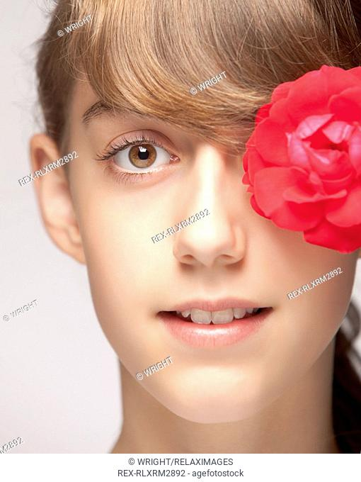 Girl portrait face flower red pretty cute close up