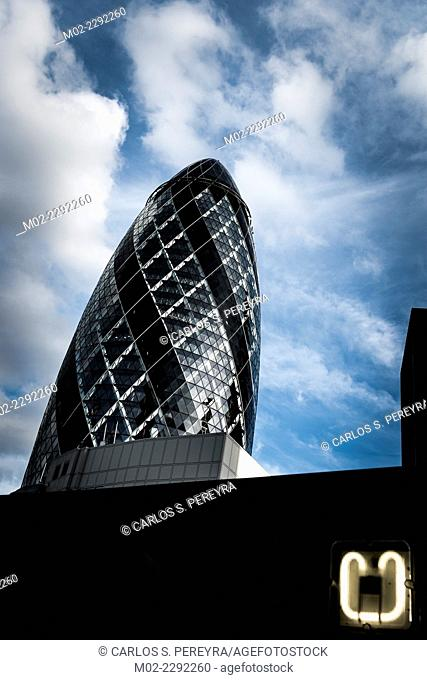 The modern glass buildings of the Swiss Re Gherkin on July 28, 2007 in London, England. This tower is 180 meters tall and stands in the City of London Financial...