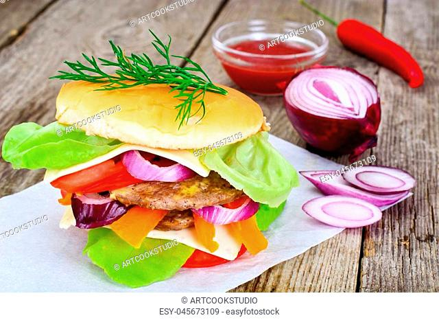 Burger on a Wooden Rustic Background Studio Photo