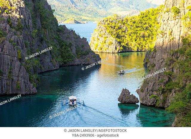 Outrigger boats in small rocky inlet on Coron Island, Coron, Palawan, Philippines