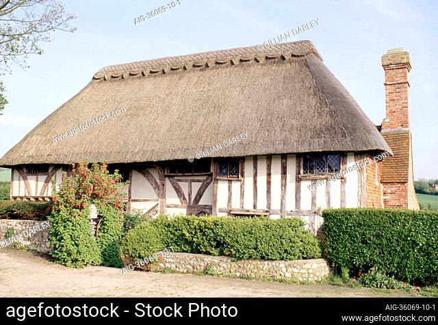 14th century thatched Wealden hall house. Timber - framed, brick chimney stack. Alfriston Clergy House, East Sussex. 14th C