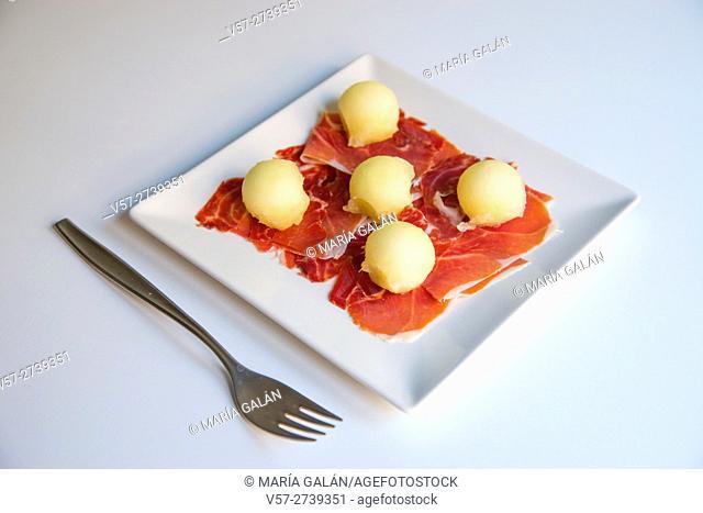 Iberian ham with melon balls