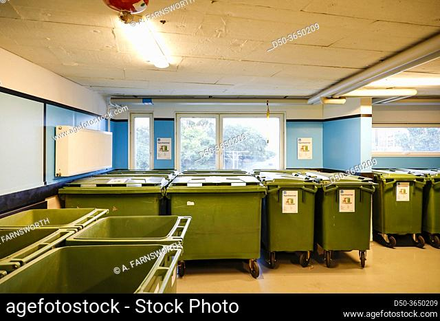 Stockholm, Sweden A garbage room in a residential apartment building with bins for different types of garbage