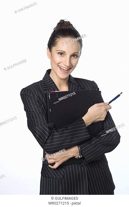 Young woman holding file, thinking