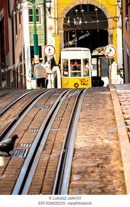 yellow tram in center of lisbon,portugal symbol
